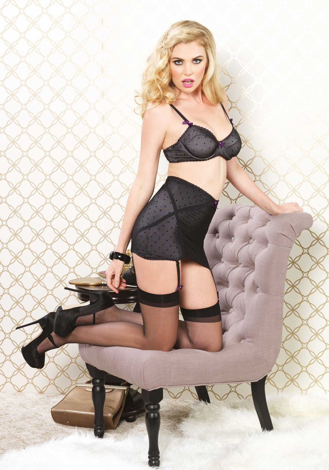 The sheer girdle garter with cross detailed straps combined with the sheer detailed bra makes this set very cheeky whereas the polkadot detail adds cuteness. The girdle garter will complement your figure and will definitely be comfortable to wear because of the soft material. It is also ideal to wear under a dress or skirt. Set also includes matching g-string.