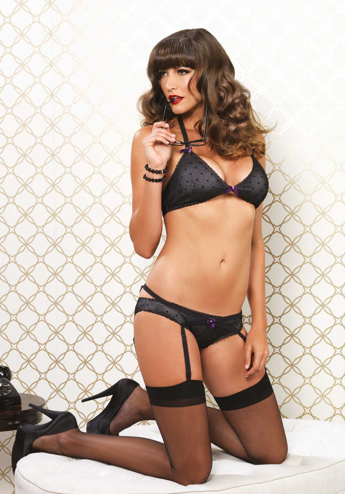 The cross strap detail on the garter panty makes this set extra compelling. The sheer fabric and polkadot print adds flirtatiousness and sexiness to the set.