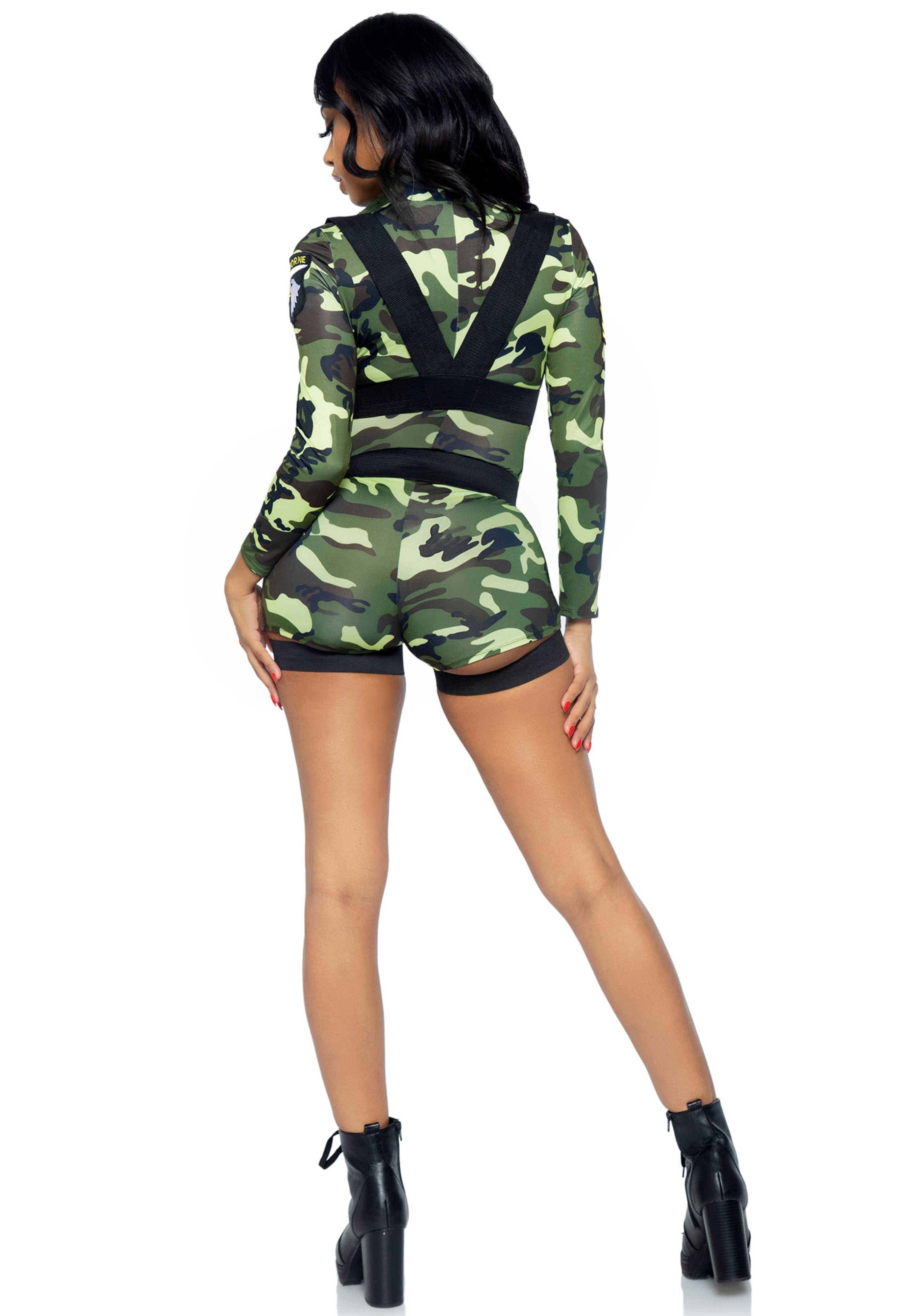 This 'Goin' Commando' costume is only for tough girls! The set includes a zipper front spandex romper and body harness. This costume runs small. when in doubt, we recommend to go one size up.