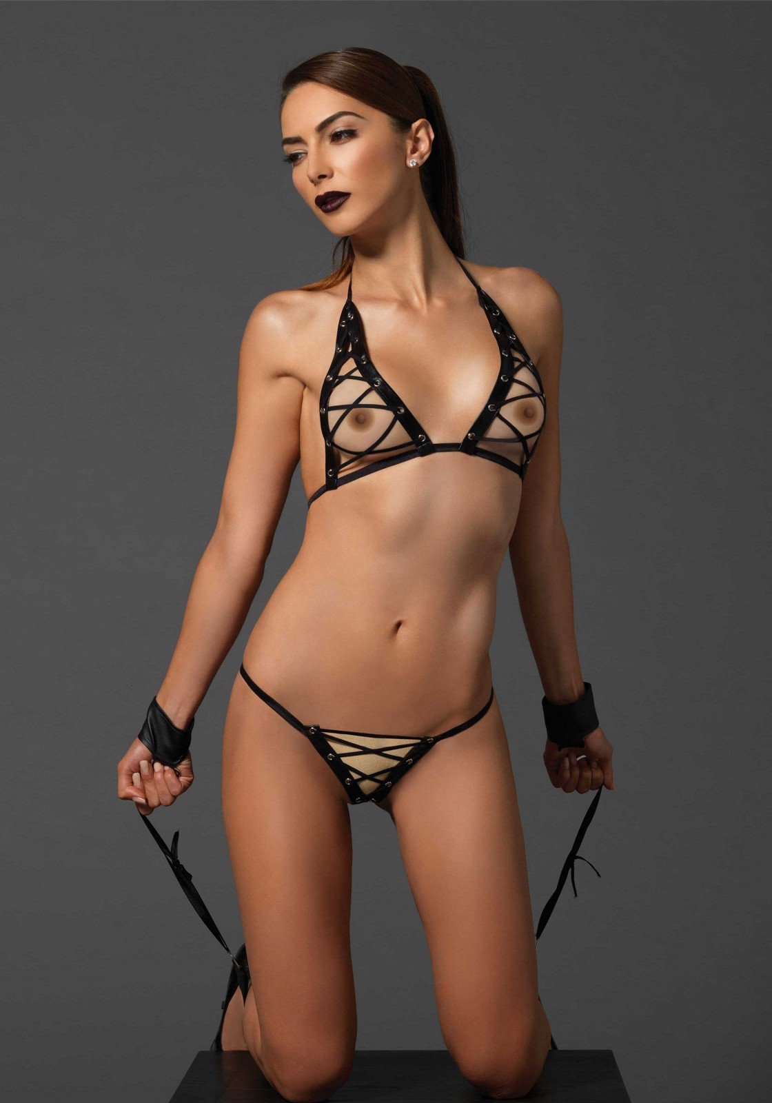 3 PC. Grommet lace up bra with elastic straps, g-string and D-ring velcro closure wrist-ankle restraints.