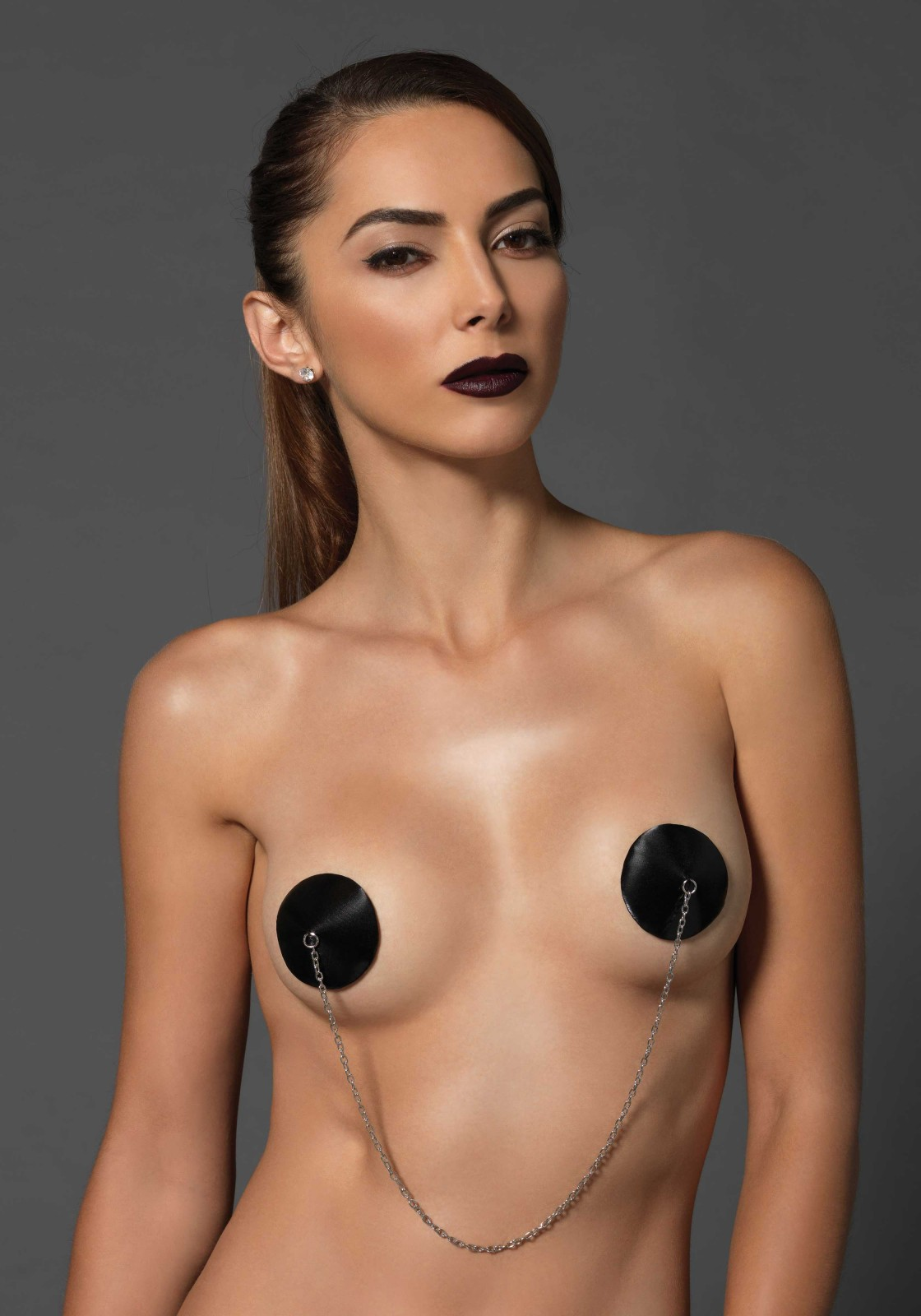 Padded satin nipple covers with connecting chain.
