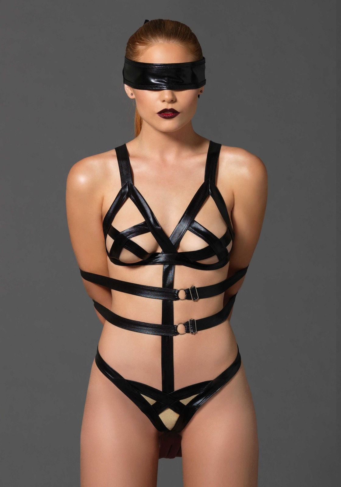 3 PC. G-string teddy with adjustable arm straps and hook-n-eye closure, eye mask and wrist restraints.